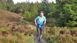 Woman running in Delamere Forest