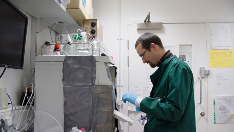 Researcher setting up machinery