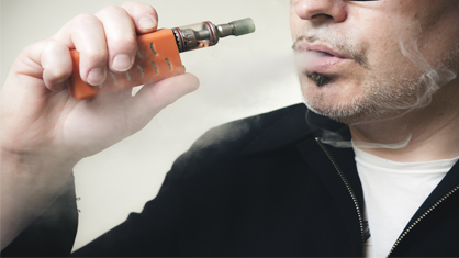 Person using an e-cigarette