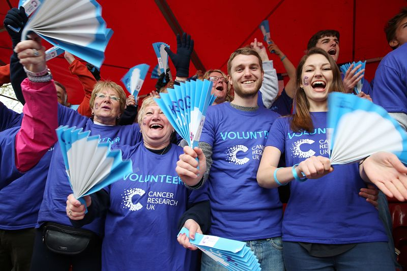 Volunteers cheering at an event