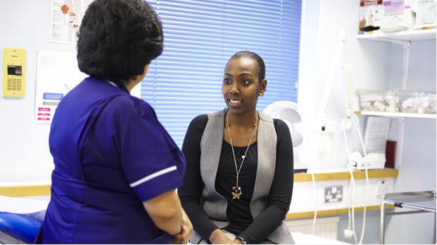 Image of nurse speaking to patient