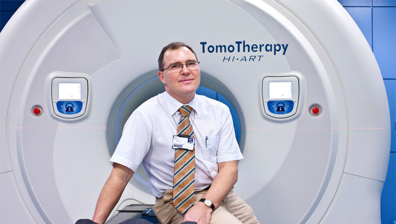 Doctor sitting by radiotherapy machine