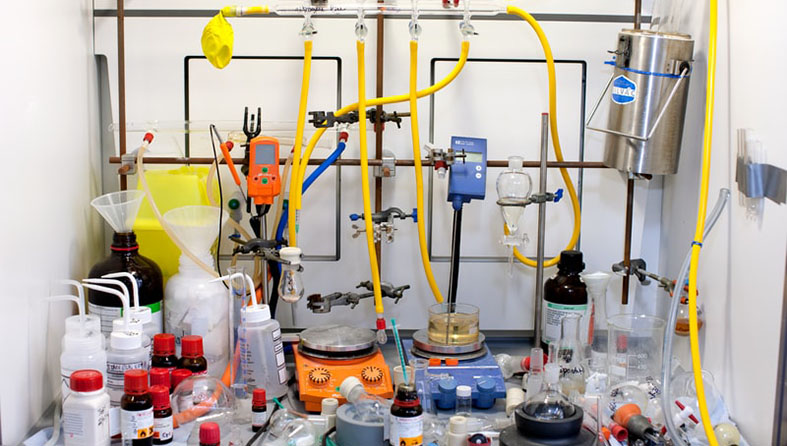 Bottles and equipment in a fume cupboard