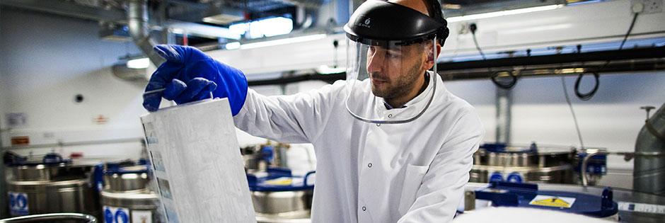 Scientist holding frozen samples