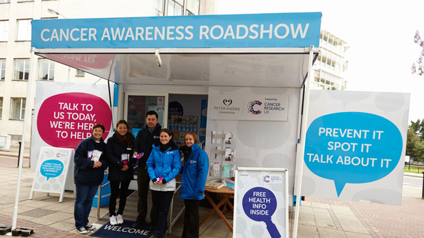 members of the Cancer Awareness Roadshow team outside the unit