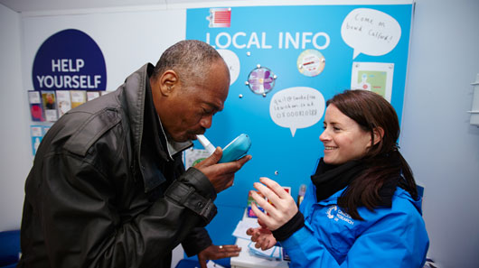 Man taking a smokelizer test at the Cancer Awareness Roadshow