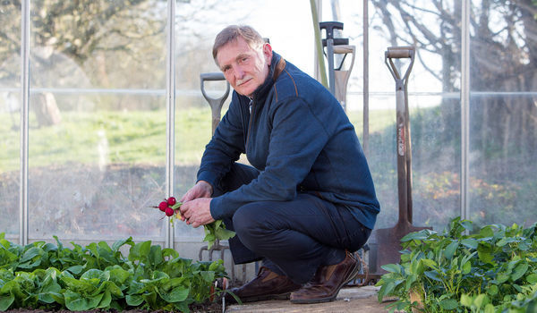 Tony who has oesophageal cancer in his greenhouse