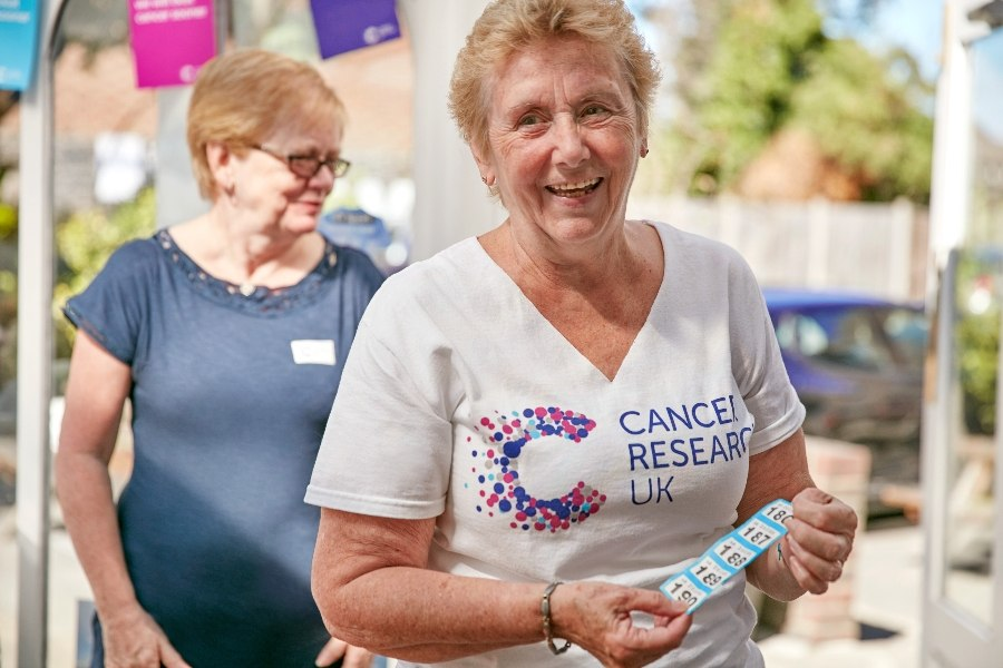 Smiling middle-aged female CRUK supporter