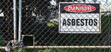 Danger asbestos sign on a fence