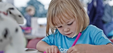 A young girl colouring