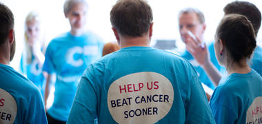 People wearing beat cancer sooner tshirts