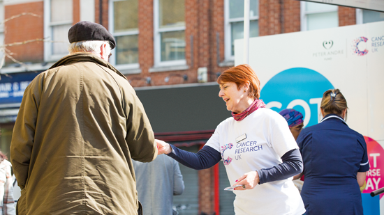 Picture of woman handing flyer to man