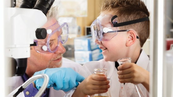 Kid and scientist doing an experiment