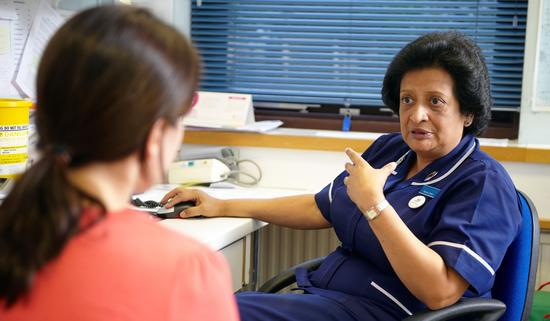 Research nurse talking to a patient
