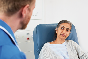 woman talking to health professional