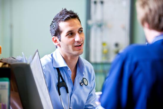 A photo of a GP talking to a nurse
