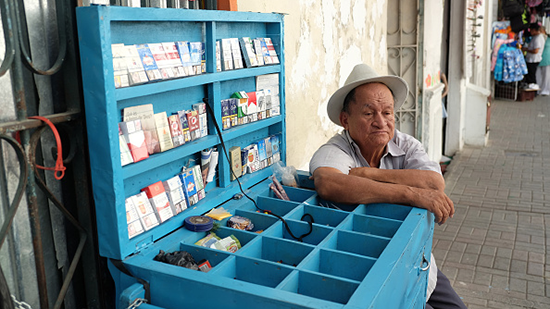 Image of man selling cigarettes