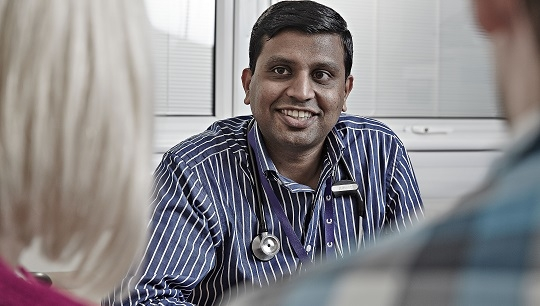 Male Asian doctor with patients