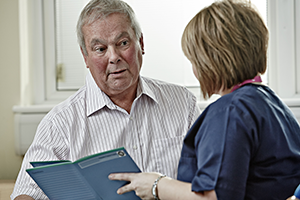 Image of doctor speaking to patient