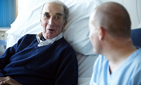 Male patient speaking with a male nurse