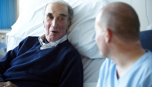 Male patient talking to a male nurse