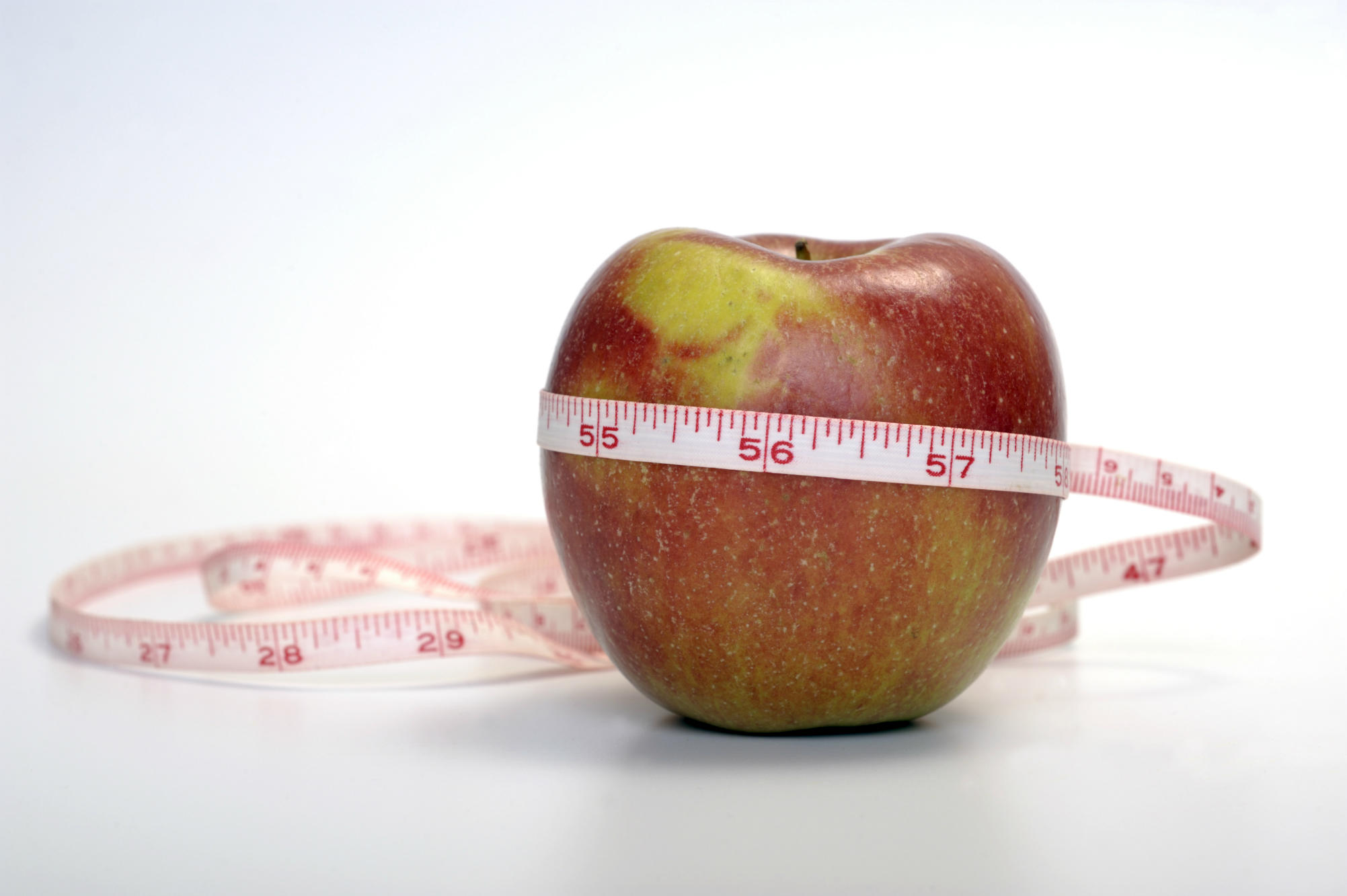 An obesity campaign apple with a measuring tape