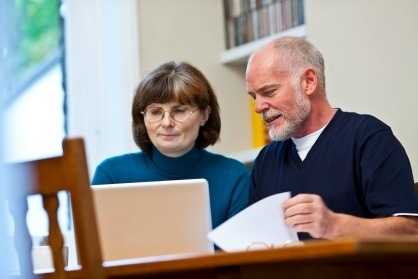 A couple at home browsing the website