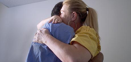 Patient hugging nurse.
