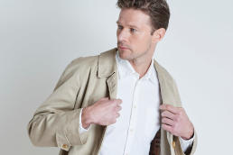 A model wearing a light beige coloured Burberry's trench coat