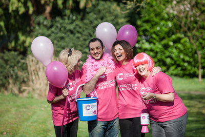 people raising money for breast cancer research