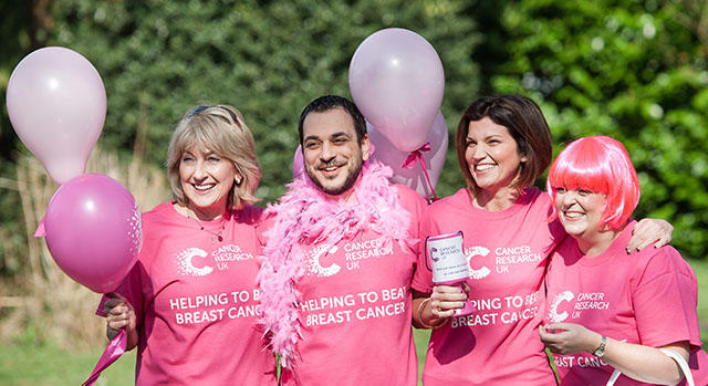 A group of fundraisers at a breast cancer research fundraising event