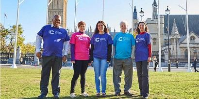 A group of CRUK campaigners stood together in the sun