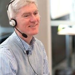 Male nurse wearing a telephone headset