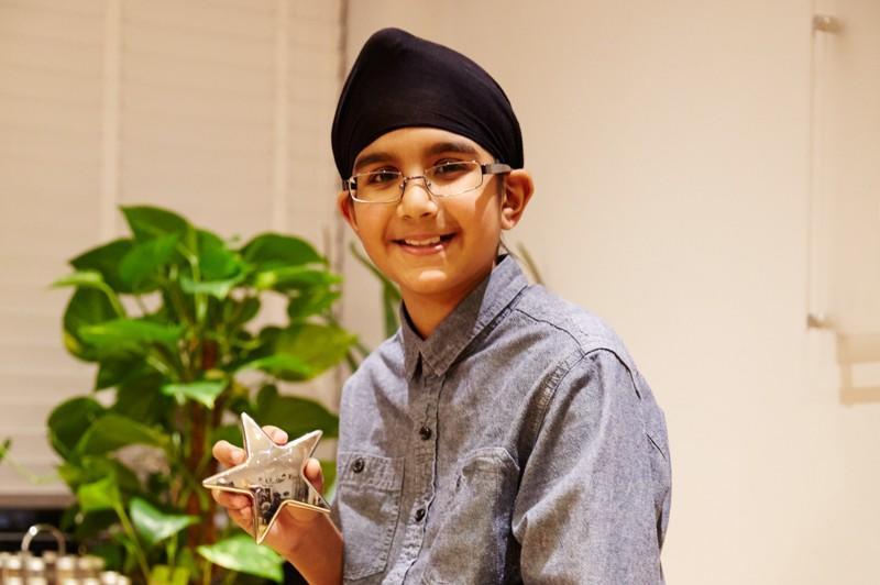 Amarvir holding a star