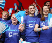 Cancer Research UK volunteers cheering on runners at an event