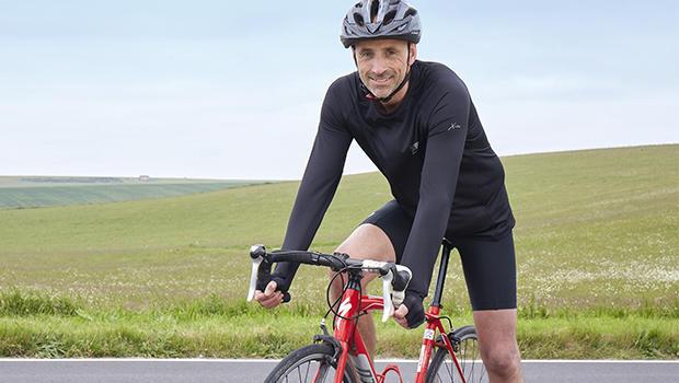 Cyclist on bike. Cycle 300 miles.