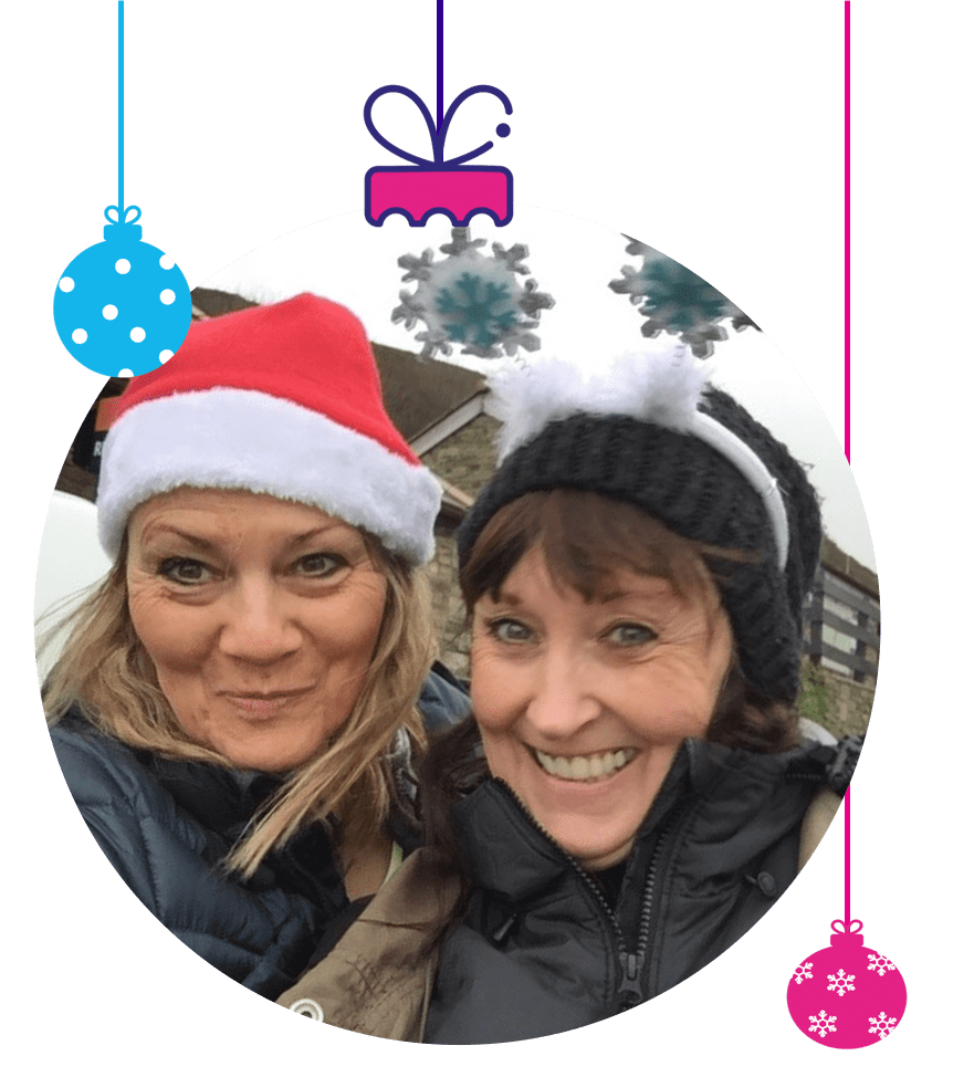 Woman in Christmas hat and friend