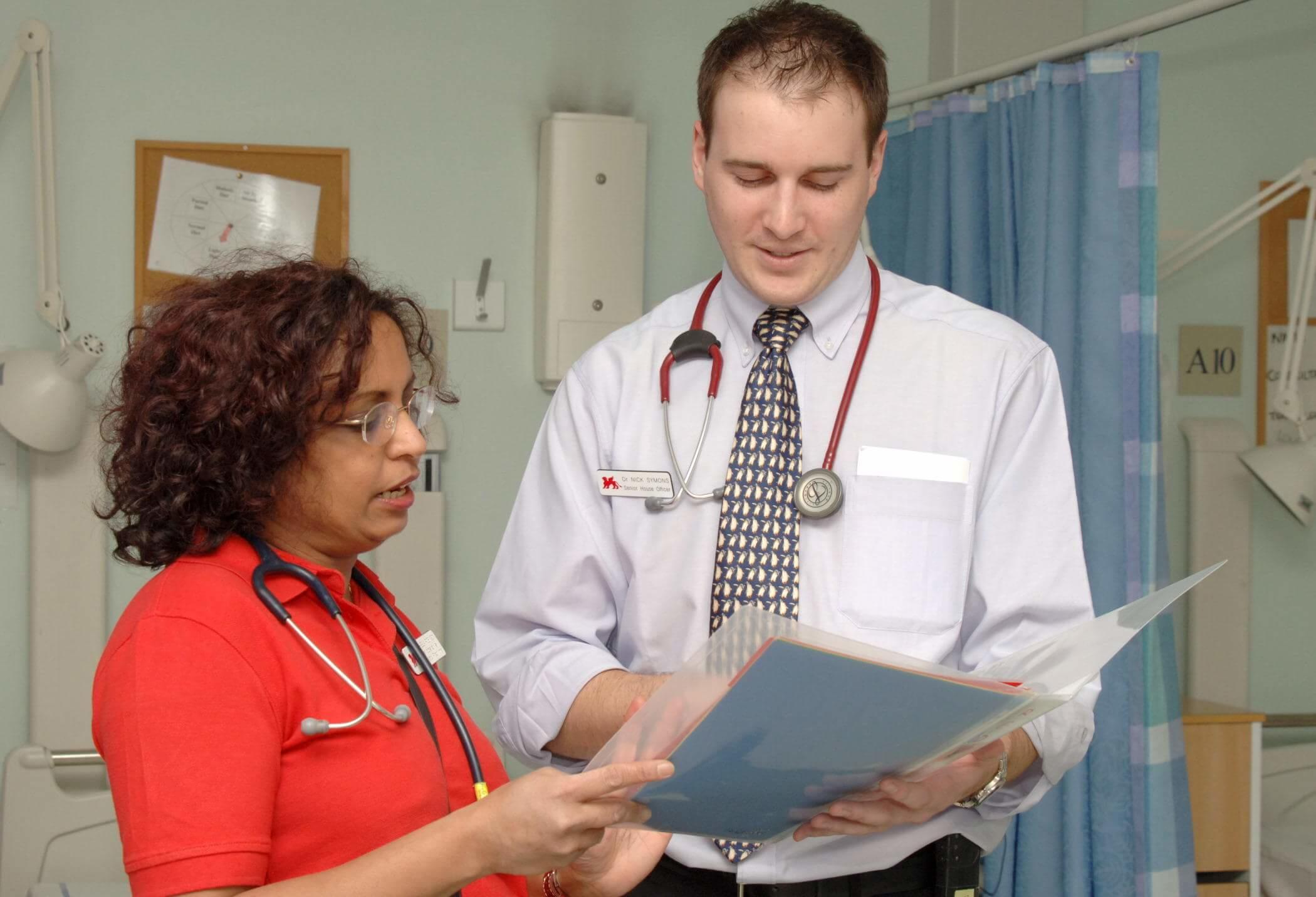 Doctors discussing notes