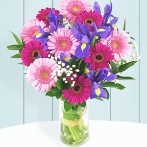 A bouquet of flowers in a glass vase