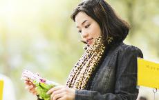 Woman ponders vegetables in the food market