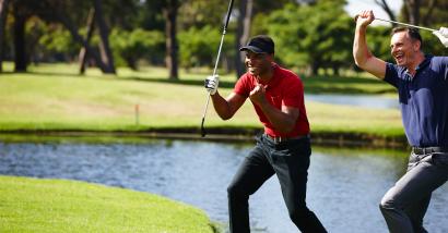 Two men celebrating while playing golf.