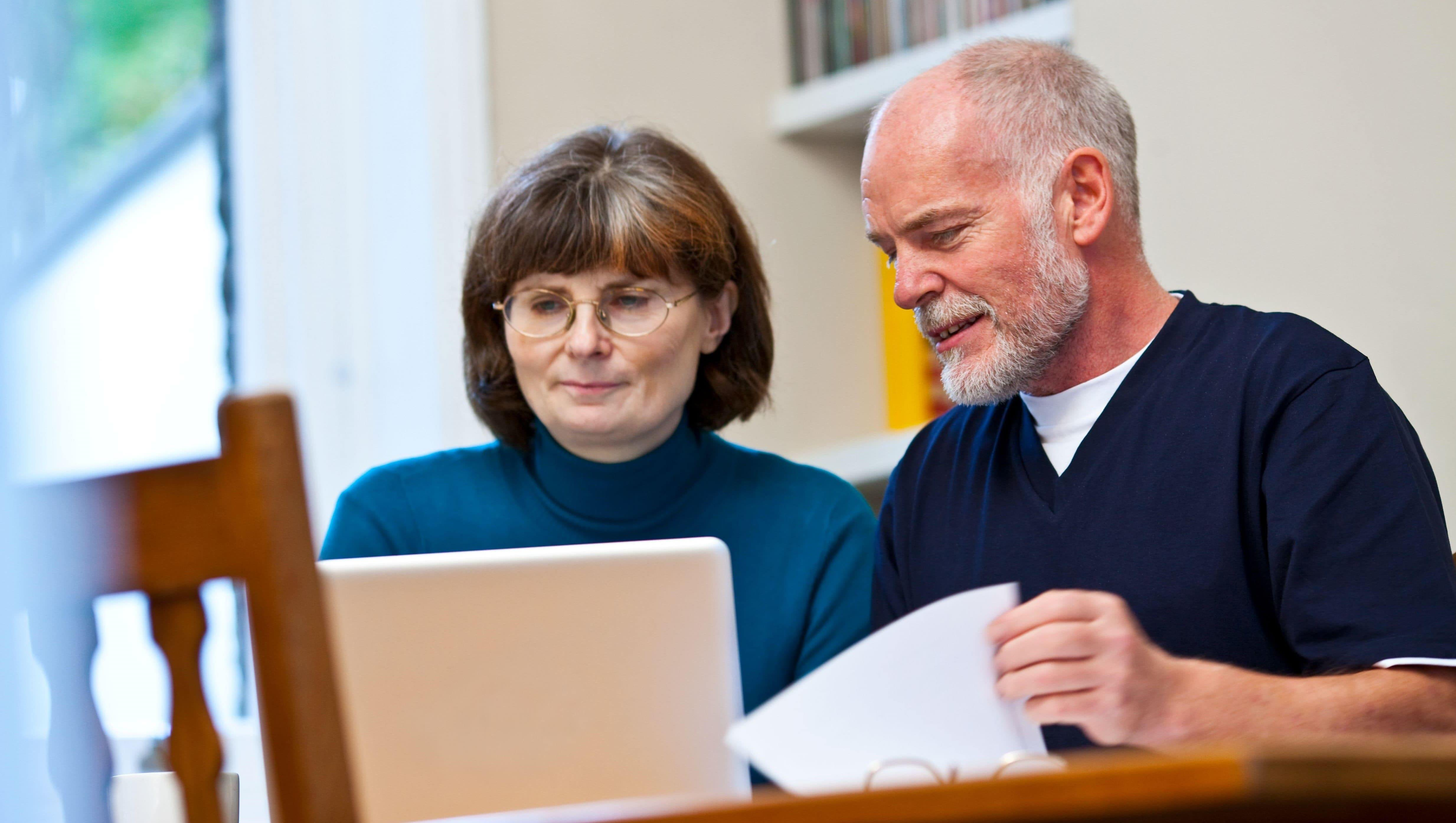A couple using the Free Will Service online
