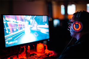 Man playing computer game with headset on