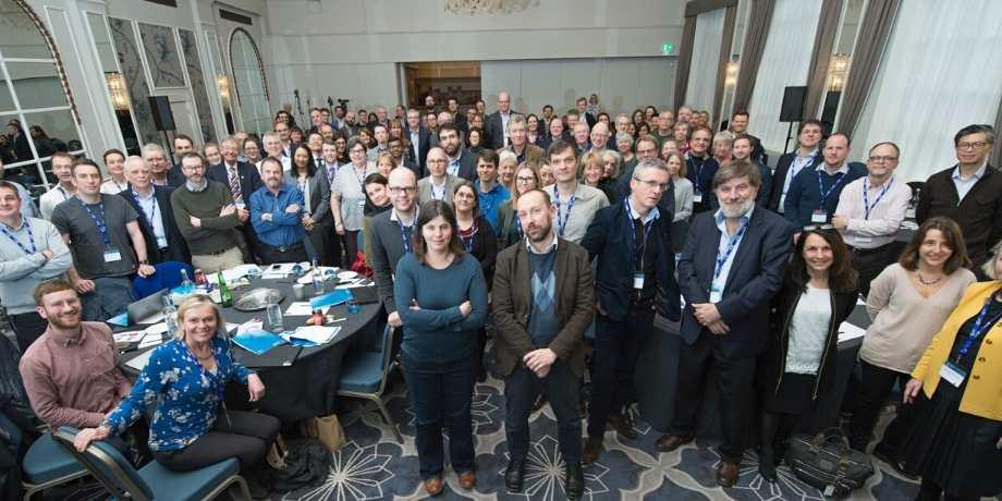 Grand Challenge-funded researchers standing together
