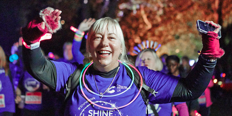 Photo of a fundraiser celebrating during their Shine Night Walk