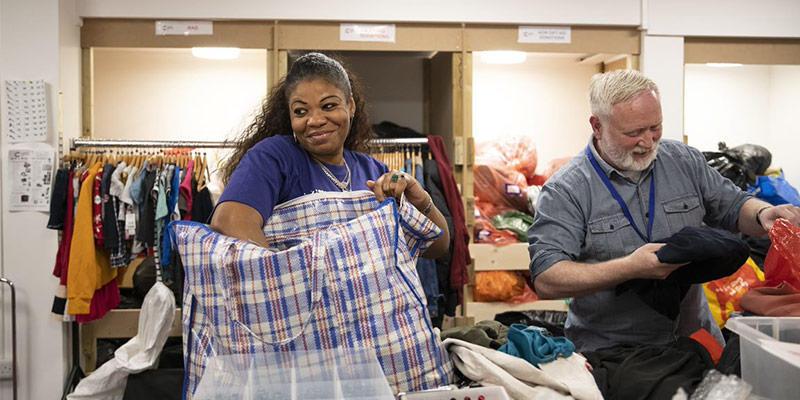 Photo of volunteers help unpack donated items