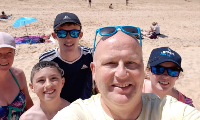 Graeme on the beach with family
