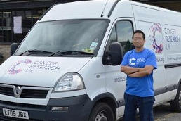 A driver with a Cancer Research UK van
