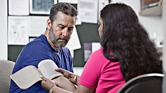 GP and patient blood pressure cuff