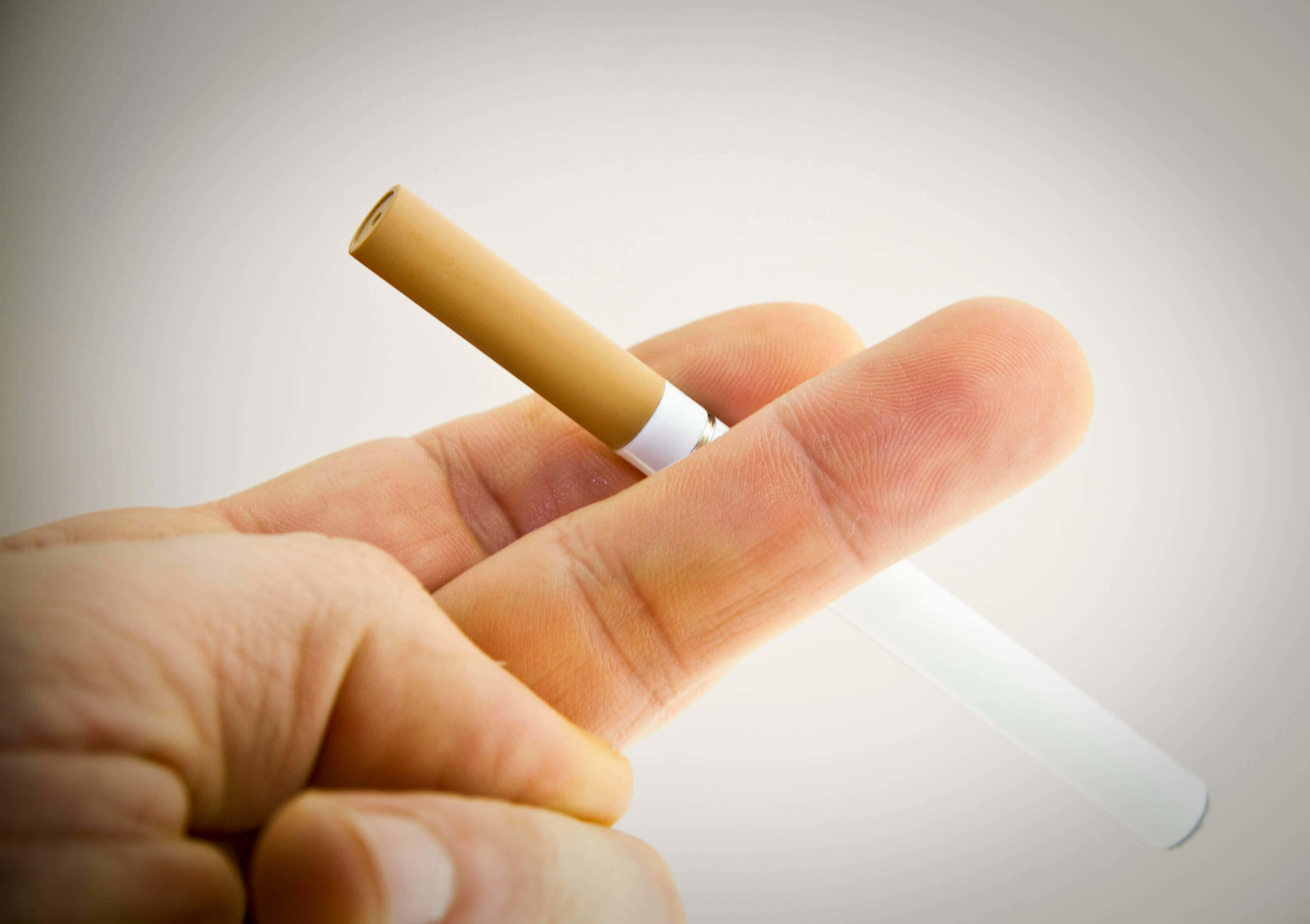 Hand with an e-cigarette
